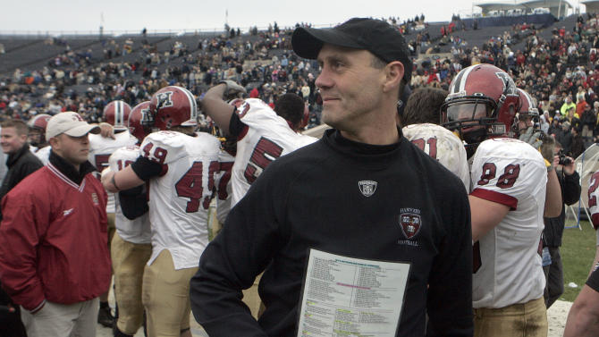 In this Nov. 17, 2007, file photo, Harvard football coach Tim Murphy smiles after his team defeated Yale 37-6 in an NCAA college football game to win the Ivy League title at the Yale Bowl in New Haven, Conn. With a hands-on approach, Murphy has built an Ivy League empire during two decades at Harvard and become the winningest coach in school history