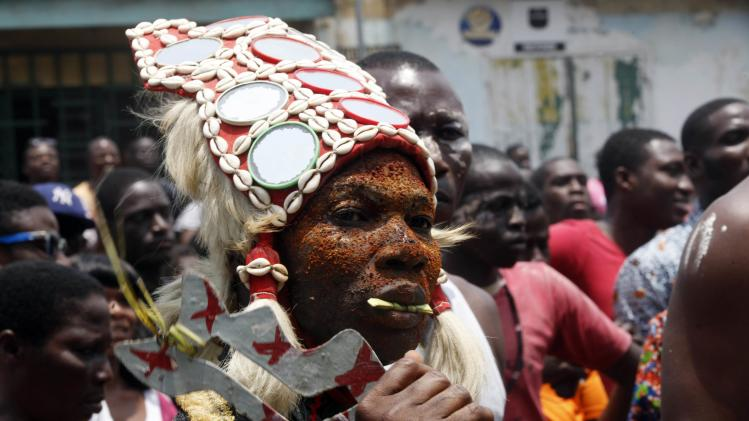 Man from the Tchagba generation, dressed as a warrior, performs a combat dance during the Generation Festival in Anoumabo, in Abidjan