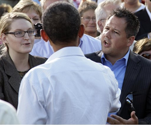 Ryan Rhodes, right, and another member of the Iowa Tea Party Revolution, speak to President Barack Obama at a town hall meeting, Monday, Aug. 15, 2011, at the Seed Savers Exchange in Decorah, Iowa, during his three-day economic bus tour.  (AP Photo/Carolyn Kaster)