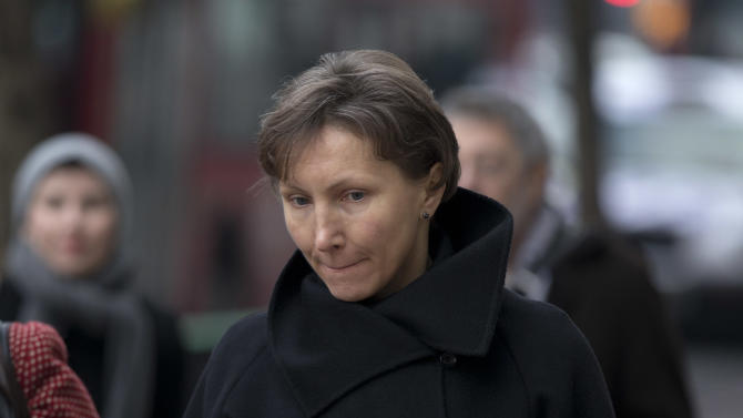 FILE - Marina Litvinenko, the widow of former Russian intelligence officer Alexander Litvinenko, arrives for the first day of a scheduled two-day Pre-Inquest Review at Camden Town Hall in London, in this Thursday, Dec. 13, 2012 file photo. British officials have refused to hold a public inquiry into the death of Russian intelligence officer Alexander Litvinenko, a coroner said Friday, July 12, 2013, quashing what he described as the best hope of finding out what lay behind the high-profile poisoning. Robert Owen said the government turned down his request for an inquiry, adding that it was now unclear when or even if his inquest could begin. (AP Photo/Matt Dunham, File)