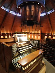 The circular pipe organ is shown at the Agnes Flanagan Chapel Tuesday, June 12, 2012, on the campus of Lewis & Clark College, in Portland, Ore. The Agnes Flanagan Chapel is a 16-sided architectural marvel that seats 650 under stained glass windows depicting the book of Genesis. In the early 1970s, it was also a big, conical quandary. Chapels arent really chapels unless they have an organ, and the newly-minted structure at Portlands Lewis & Clark College was in need. (AP Photo/Rick Bowmer)