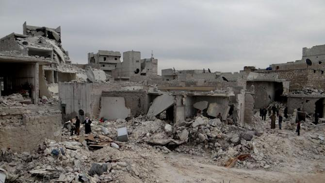In this citizen journalism image provided by Aleppo Media Center AMC which has been authenticated based on its contents and other AP reporting, Syrian citizens inspect destroyed houses that were destroyed from a Syrian forces airstrike, at al-Marjeh neighborhood, in Aleppo, Tuesday March 19, 2013. Syria's state-run news agency says 25 people have been killed in an alleged rebel chemical attack in northern Syria. Rebels in northern Syria deny the government claim and blamed regime forces for Tuesday's missile attack on Khan al-Assad village in northern Aleppo province. (AP Photo/Aleppo Media Center, AMC)