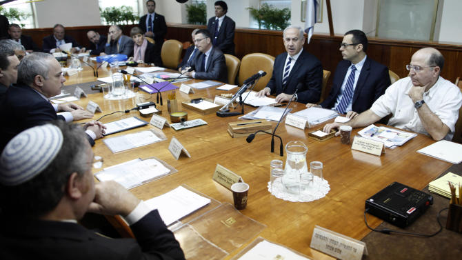 Israeli Prime Minister Benjamin Netanyahu, third right, together with Cabinet Minister Moshe Yaalon, right, and Cabinet Secretary Zvi Hauser, second right, attend the weekly cabinet meeting in the prime minister's Jerusalem office, Sunday, Dec. 2, 2012. Israel has rejected the borders of a future Palestinian state the U.N. endorsed last week and on Friday, Israel announced it would press ahead plans to build thousands of settler homes.. And it is punishing the Palestinians further by withholding more than $100 million in taxes and other funds collected on their behalf. (AP Photo/Lior Mizrahi, Pool)