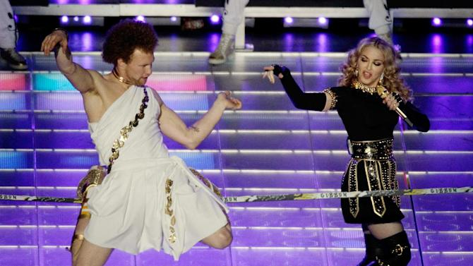 Madonna performs during halftime of the NFL Super Bowl XLVI football game between the New York Giants and the New England Patriots, Sunday, Feb. 5, 2012, in Indianapolis. (AP Photo/Charlie Riedel)