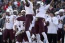 Arizona State defenders Damarious Randall, left, and Chad Adams celebrate an interception during the fourth quarter of the Sun Bowl NCAA college football game against Duke, Saturday, Dec. 27, 2014, in El Paso, Texas. Arizona State won 36-31. (AP Photo/Victor Calzada)