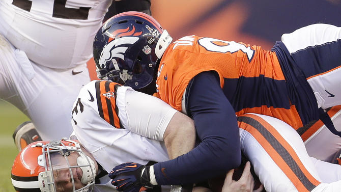 Cleveland Browns quarterback Brandon Weeden (3) is sacked by Denver Broncos defensive end Elvis Dumervil (92) in the third quarter of an NFL football game, Sunday, Dec. 23, 2012, in Denver. (AP Photo/Joe Mahoney)