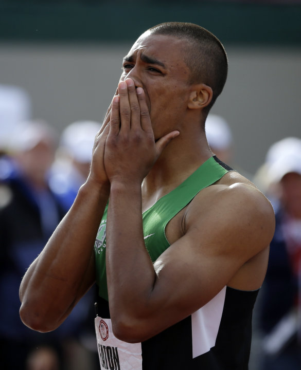 Ashton Eaton reacts after the 1500m during the decathlon competition at the U.S. Olympic Track and Field Trials Saturday, June 23, 2012, in Eugene, Ore. Eaton finished the decathlon with a new world r
