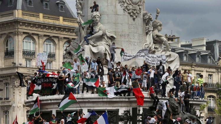 Protesters gather at Place de la Republique during a banned demonstration in support of Gaza in central Paris