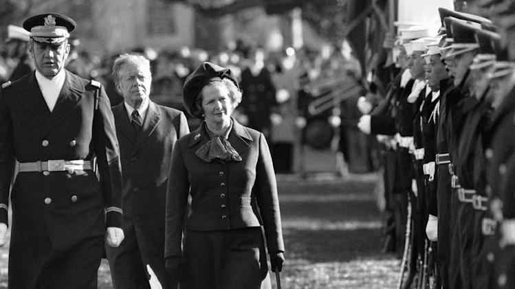 "FILE - In this Dec. 17, 1979 file photo, British Prime Minister Margaret Thatcher  reviews the honor guard at the White House in Washington, as President Jimmy Carter follows.  At left in Col. Stanley Bonta, commander of the guard. Ex-spokesman Tim Bell says that Thatcher has died. She was 87. Bell said the woman known to friends and foes as ""the Iron Lady"" passed away Monday morning, April 8, 2013. (AP Photo/File)"
