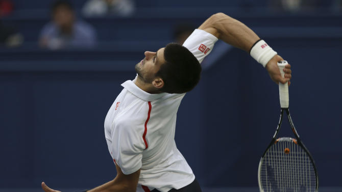 Novak Djokovic of Serbia serves to Feliciano Lopez of Spain during their third round men's singles match of the Shanghai Masters tennis tournament at Qizhong Forest Sports City Tennis Center in Shanghai, China, Thursday Oct. 11, 2012. Novak Djokovic won 6-3, 6-3. (AP Photo/Kin Cheung)