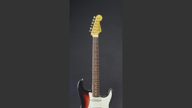 Dylan's Newport guitar sells in NY for $965,000