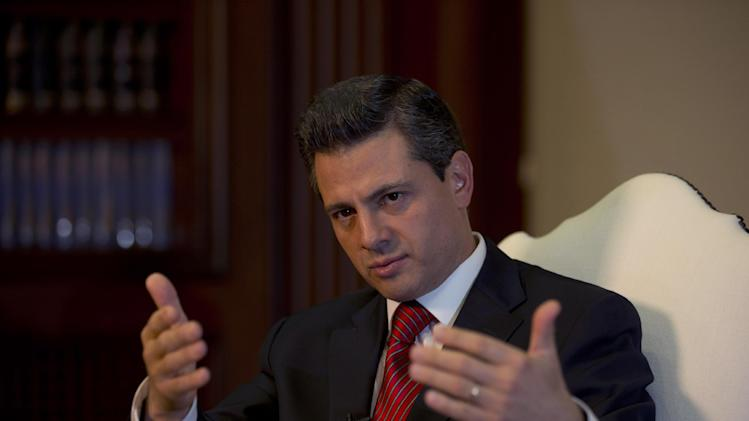 "Enrique Pena Nieto speaks during an interview with The Associated Press at the Los Pinos presidential residence in Mexico City, Monday, Dec. 10, 2012. Pena Nieto says he'll mount a ""real fight"" against production and trafficking of marijuana, despite its legalization in two U.S. states. (AP Photo/Dario Lopez-Mills)"