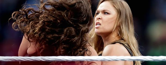 Rousey steps into WWE ring, tosses Triple H