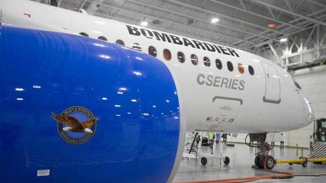Bombardier's CS300 Aircraft showing its' Pratt & Whitney engine in the foreground sits in the hangar prior to its' test flight in Mirabel