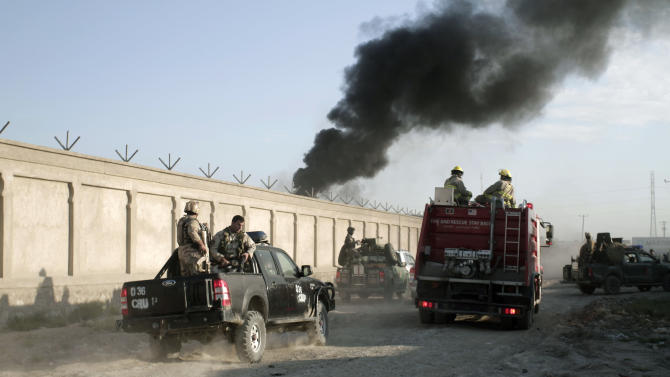 Afghan security forces arrive near the entrance gate of a NATO compound following a suicide bombing in Kabul, Afghanistan, Tuesday, July 2, 2013. Militants blew up a suicide car bomb at the gate to the NATO compound in Kabul early Tuesday and attacked guards with small-arms fire, killing four guards and two civilians, police said. All four suicide attackers were also killed. (AP Photo/Rahmat Gul)