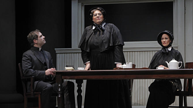 """In this Jan. 23, 2013 photo provided by the Minnesota Opera, Matthew Worth as Father Brendan Flynn, a parish priest, Christine Brewer, center, as Sister Aloysius Beauvier, the school principal and Adriana Zabala as Sister James, a teacher and a nun, perform during a dress rehearsal for the Jan. 26 world premiere of """"Doubt"""" at the Minnesota Opera Center in Minneapolis. (AP Photo/Minnesota Opera, Michal Daniel)"""