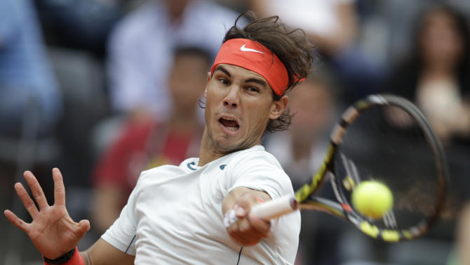 Spain's rafael Nadal returns the ball to Latvia's Ernests Gulbis during their match at the Italian Open tennis tournament in Rome, Thursday, May 16, 2013. (AP Photo/Andrew Medichini)