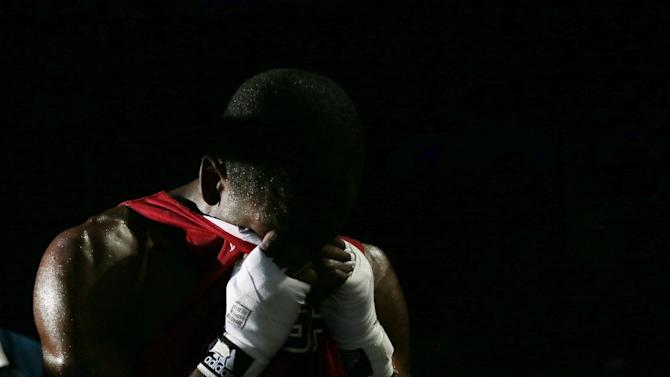 Jamel Herring, of the United States reacts after being defeated by Kazakhstan's Daniyar Yelessinov in their men's light welter 64-kg boxing match at the 2012 Summer Olympics, Tuesday, July 31, 2012, in London. (AP Photo/Ivan Sekretarev)