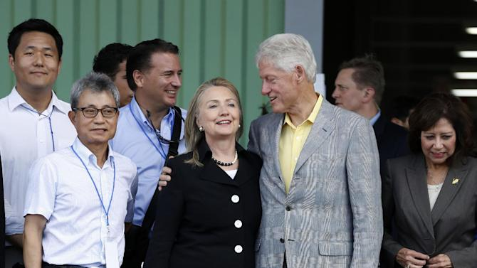 Former President Bill Clinton, his wife Secretary of State Hillary Rodham Clinton, Labor Secretary Hilda Solis, right and others,  attend the grand opening ceremony of the new Caracol Industrial Park in Caracol, Haiti, Monday, Oct, 22, 2012.  The Clintons arrived in northern Haiti Monday leading a delegation of foreign investors and a crowd of celebrities to showcase the centerpiece of the U.S. effort to help the country recover from the 2010 earthquake.  (AP Photo/Larry Downing, Pool)