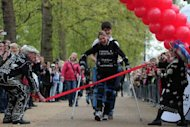 "Claire Lomas, who is paralysed and walks with the aid of a ""bionic"" suit, finishes the London Marathon, 16 days after the event began. The former chiropractor was in tears as she became the first person to complete any marathon using a bionic ReWalk suit"
