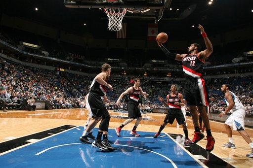 MINNEAPOLIS, MN - FEBRUARY 4:  LaMarcus Aldridge #12 of the Portland Trail Blazers grabs a rebound during the game between the Minnesota Timberwolves and the Portland Trail Blazers on February 4, 2013 at Target Center in Minneapolis, Minnesota. (Photo by David Sherman/NBAE via Getty Images)