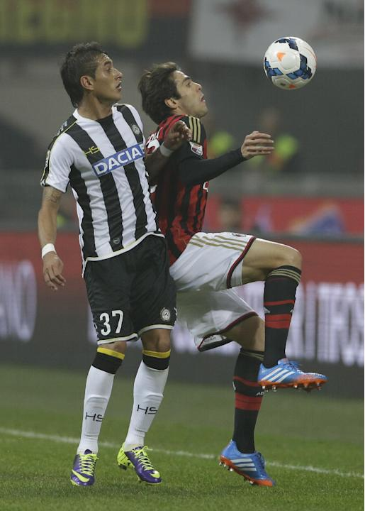 AC Milan Brazilian forward Ricardo Kaka', right, challenges for the ball with Udinese midfielder Maximiliano Roberto Pereyra of Argentina during a Serie A soccer match between AC Milan and Udinese, at
