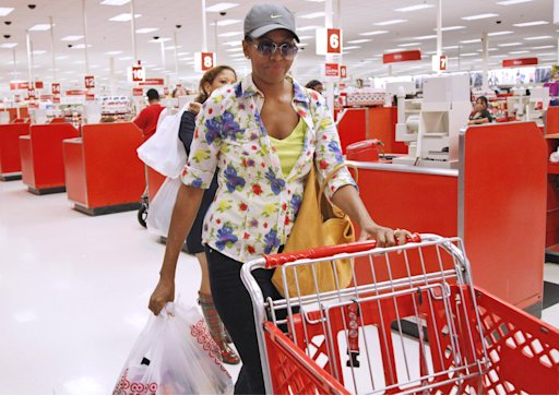 First lady Michelle Obama, wearing a hat and sunglasses, stands in line at a Target department store in Alexandria, Va., Thursday, Sept. 29, 2011, after doing some shopping.  (AP Photo/Charles Dharapak)