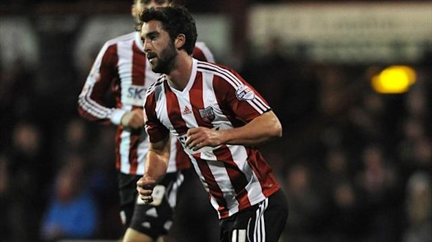 Brentford's Will Grigg sealed the points for his side with their second goal in a 2-0 win against Port Vale