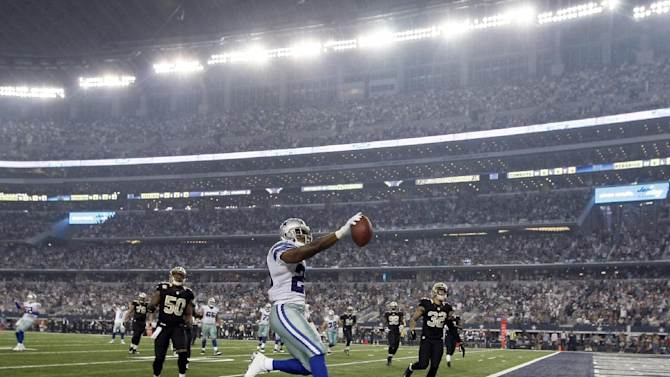 Romo, Murray lead Cowboys past Saints 38-17