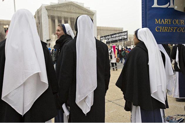 Anti-abortion activists march past the Supreme Court in Washington, Friday, Jan. 25, 2013, as they observe the 40th anniversary of the Roe v. Wade decision. Thousands of anti-abortion demonstrators ma