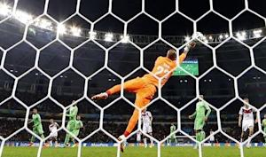 Algeria's goalkeeper Rais Mbolhi makes a save during the 2014 World Cup round of 16 game between Germany and Algeria at the Beira Rio stadium