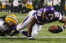 Minnesota Vikings' Peterson scores a touchdown past Green Bay Packers' Jennings on a seven-yard carry during their NFL football game in Minneapolis