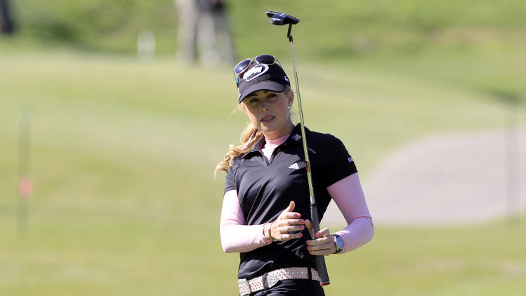 Paula Creamer tries to coax a long putt into the 17th hole during the first round of the North Texas LPGA Shootout golf tournament. Thursday, April 25, 2013, at Los Colinas Country Club in Irving, Texas. (AP Photo/John F. Rhodes)