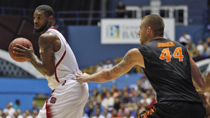 Oklahoma State's Phillip Jurick, right, pressures NC State's Richard Howell during a NCAA college basketball game in Bayamon, Puerto Rico, Sunday, Nov. 18, 2012. (AP Photo/Ricardo Arduengo
