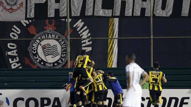 Alberto Contreras  of Paraguay's Guarani celebrates with his teammates after scoring a goal against Brazil's Corinthians during their Copa Libertadores soccer match at the Defensores del Chaco stadium in Asuncion