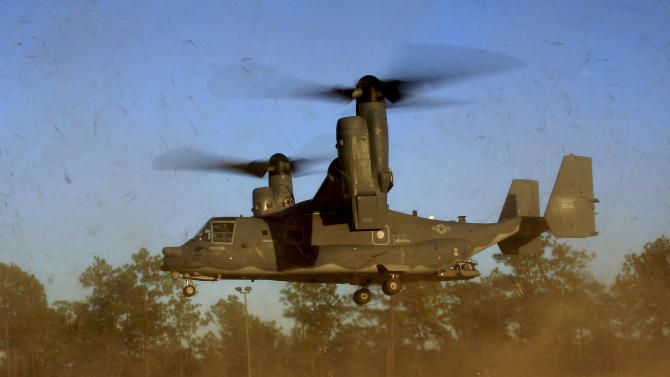 """In this photo taken Jan. 26, 2011 and released by the U.S. Air Force, a CV-22 Osprey aircraft of the 8th Special Operations Squadron (SOS) """"Black Birds"""" comes in for a landing during a local training mission at Hurlburt Field, Florida, USA. Gunfire hit three U.S. military CV-22 Osprey aircraft Saturday, Dec. 21, 2013 trying to evacuate American citizens in Bor, the capital of the remote region of Jonglei state in South Sudan, that on Saturday became a battle ground between South Sudan's military and renegade troops, officials said, with four U.S. service members wounded in the attack. (AP Photo/US Air Force, Master Sgt. Jeremy T. Lock)"""