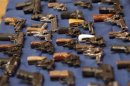 A view shows confiscated guns on a table during a news conference on major firearms trafficking cases at a news conference in New York