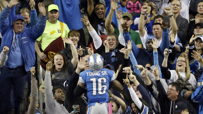Detroit Lions wide receiver Titus Young (16) celebrates his touchdown run with fans in the first half of an NFL football game against the Seattle Seahawks, Sunday, Oct. 28, 2012. in Detroit. (AP Photo/Carlos Osorio)