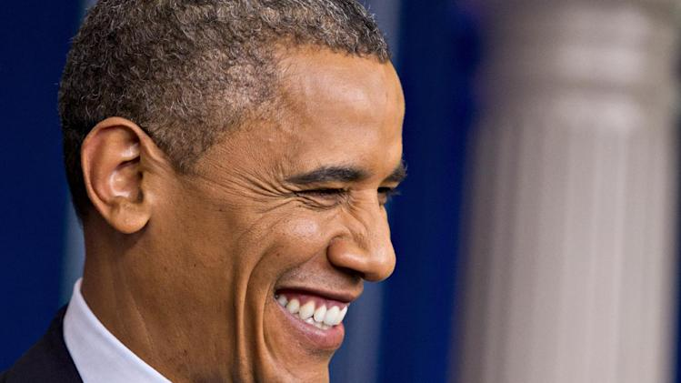 President Barack Obama grins while joking with a reporter during a news conference at the White House in Washington, Friday, June 8, 2012.   (AP Photo/J. Scott Applewhite)