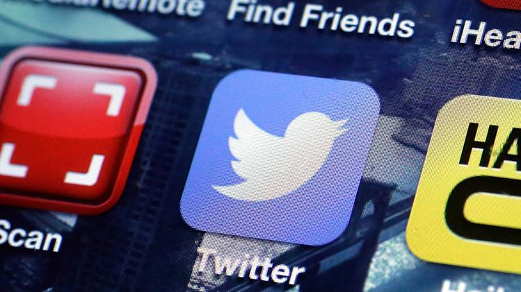 FILE - This Oct. 18, 2013, file photo shows a Twitter app on an iPhone screen in New York. Twitter Inc. said in a regulatory filing Thursday, Oct. 24, 2013, that it is putting forth 70 million shares in the initial public offering. (AP Photo/Richard Drew, File)