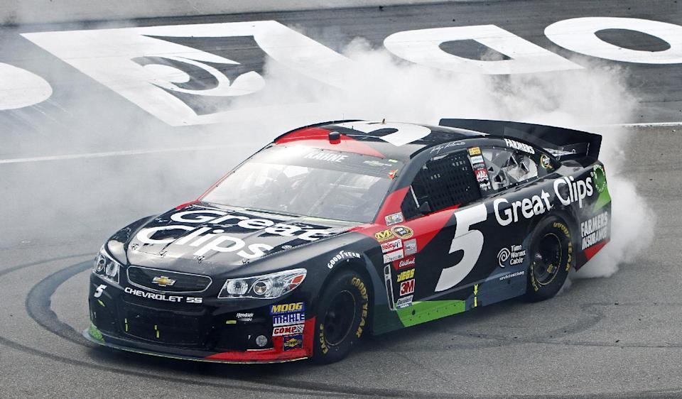 NASCAR Sprint Cup Series driver Kasey Kahne (5) does a burnout after winning the Food City 500 auto race, Sunday, March 17, 2013, in Bristol, Tenn. (AP Photo/Wade Payne)