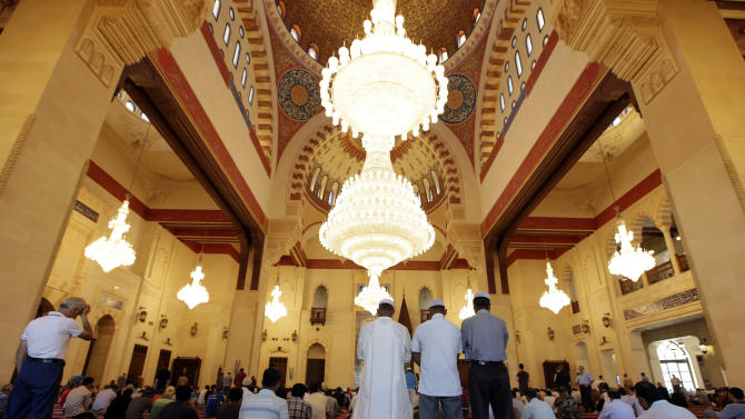 Muslims offer Friday prayers at Mohammed Al-Amin Mosque in downtown Beirut, Lebanon, Friday, Aug. 5, 2011. Muslims throughout the world are marking the holy month of Ramadan, where observants fast from dawn till dusk. (AP Photo/Bilal Hussein)