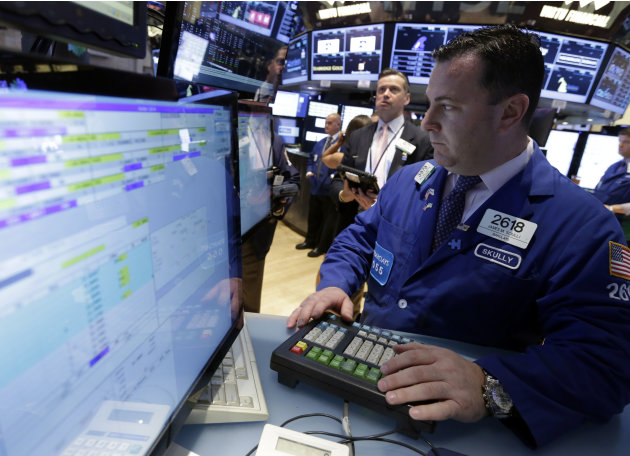 Specialist James Sciulli, right, works at his post on the floor of the New York Stock Exchange Wednesday, June 19, 2013. Stocks edged lower in early trading on Wall Street Wednesday as investors waite