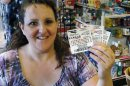 Cathy Raymond, of Oklahoma City, displays the Powerball Lottery tickets she purchased in Oklahoma City,&#8230;</p>