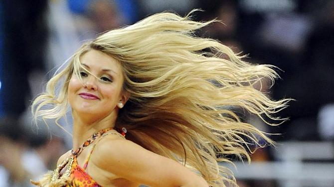 A member of the Utah Jazz Dance Team performs in the second half of an NBA basketball game against the Charlotte Bobcats, Monday, Dec. 30, 2013, in Salt Lake City. Jazz won 83-80