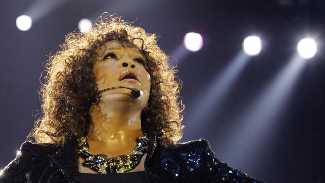 FILE - In this Sunday, April 25, 2010, file photo, U.S singer Whitney Houston performs in London as part of her European tour. Houston, 48, died Feb. 11, 2012.   (AP Photo/Joel Ryan, File)