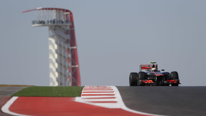 McLaren Mercedes driver Lewis Hamilton of Britain steers his car during the first free practice session for the Formula One U.S. Grand Prix, at the Circuit of the Americas race track in Austin, Texas, Friday, Nov. 16, 2012.  (AP Photo/Luca Bruno)