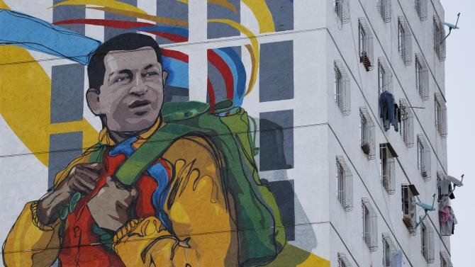 A giant mural depicting late Venezuelan President Hugo Chavez is seen on a building in Caracas