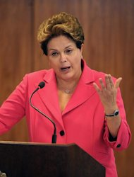 Brazilian President Dilma Rousseff delivers a speech during a press conference after the Mercosur Extraordinary Summit, at Planalto Palace in Brasilia on July 31, 2012. In the summit, Venezuela's membership to the Mercosur regional trading bloc was made official. AFP PHOTO/Pedro LADEIRA