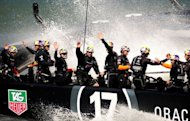 Oracle Team USA waves to spectators after winning race 16 of the America's Cup on September 23, 2013 in San Francisco